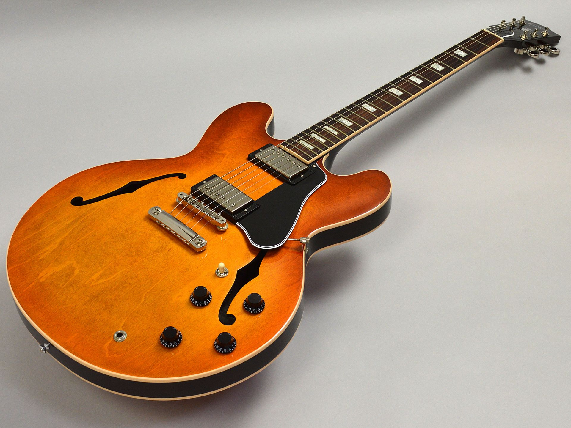 Gibson                   ES-335 Faded Lightburst (FB)